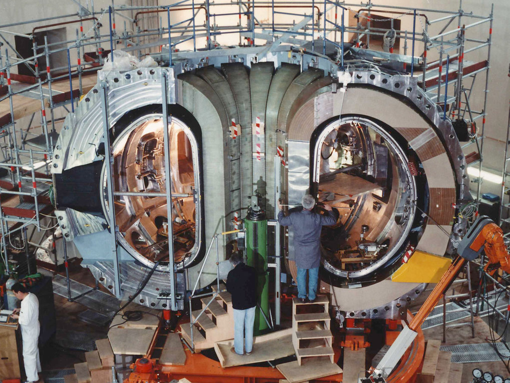 Seven of the 16 large main-field magnet coils of ASDEX Upgrade – during assembly of the device