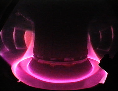 View of the many million degrees hot plasma of the ASDEX Upgrade fusion device at Garching. The plasma edge is guided to the specially equipped divertor plates at the bottom