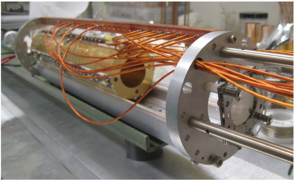 View of the interior of the particle trap for electrons or positrons. The circular phosphor screen at the front right can detect how many particles the trap encloses.