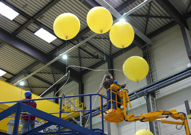 Helium-filled balloons were enlisted to levitate the sensitive superconductors carefully into the hall.